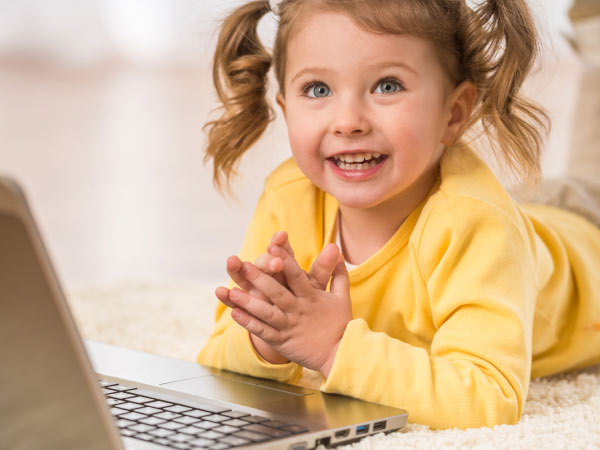 smiling girl on laptop