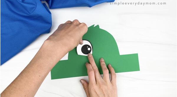 hand gluing eye to duck headband craft