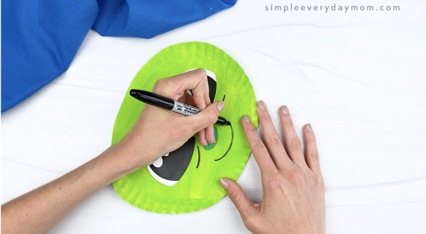 hand drawing smile on paper plate baby yoda