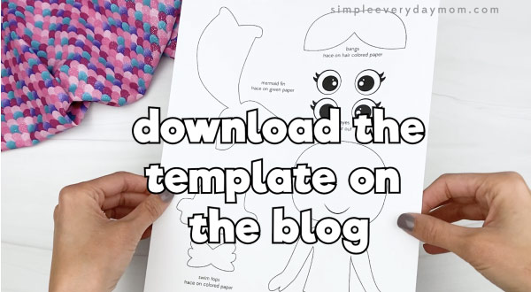 hand holding handprint mermaid craft template