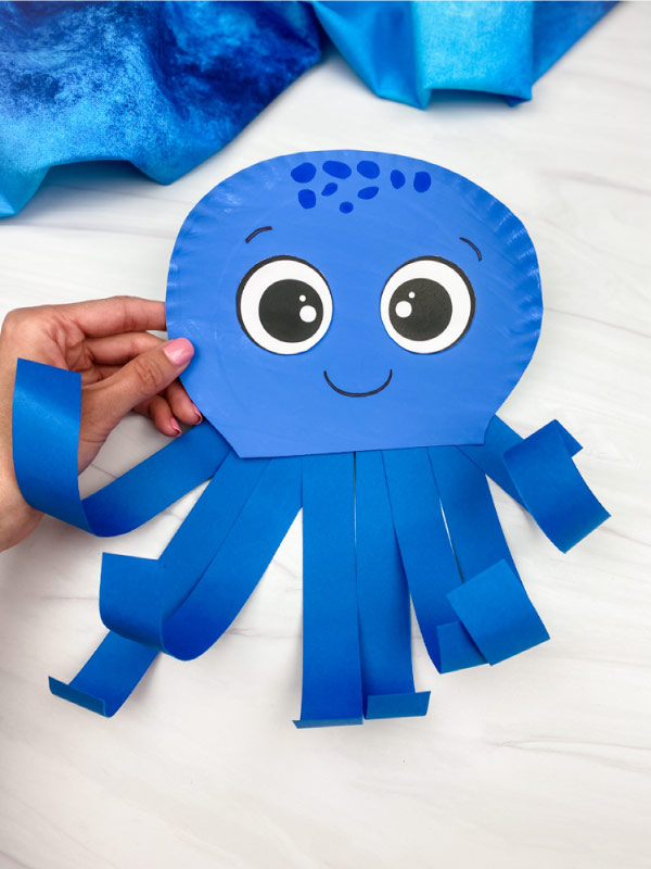 hand holding octopus paper plate craft