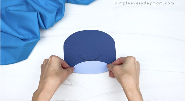 hand gluing belly onto paper plate whale craft