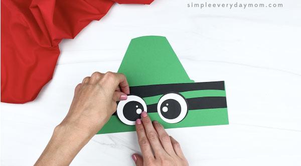 hand gluing eyes to crayon headband craft