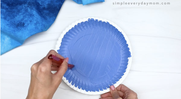 hand painting paper plate blue