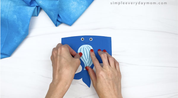 hand gluing belly to toilet paper roll humpback whale craft