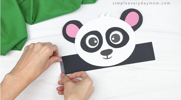 hand taping extenders to panda headband craft