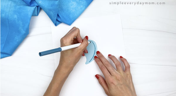hand drawing curved lines to belly