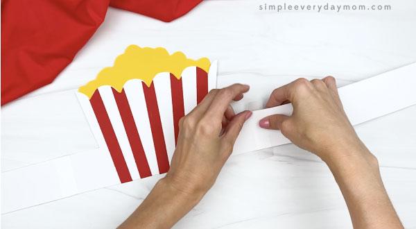 hand taping extender to popcorn headband base