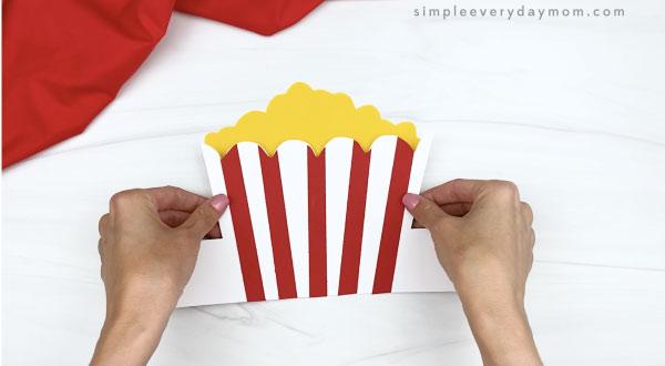 hand gluing popcorn to popcorn headband craft