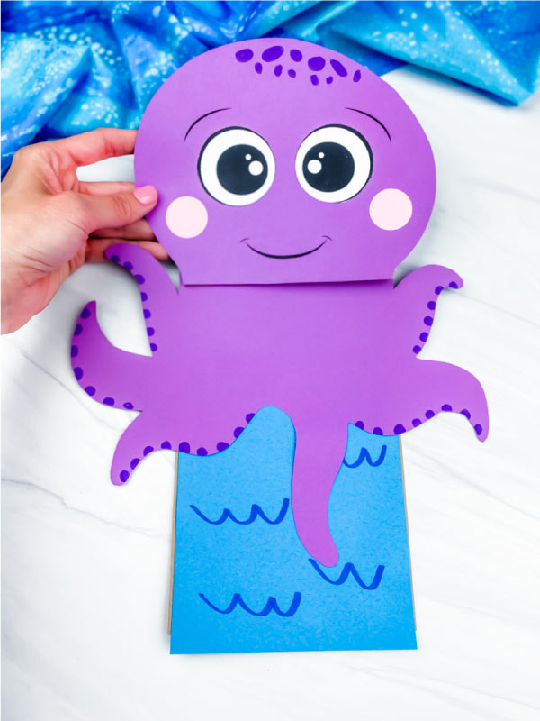 hand holding paper bag octopus craft