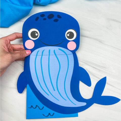 hand holding paper bag whale craft