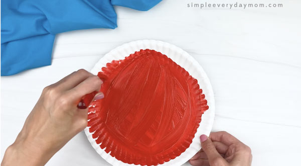 hand painting paper plate red