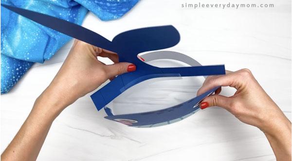 hand taping fluke to humpback whale headband craft