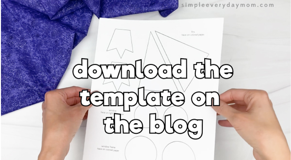 hand holding paper plate rocket template