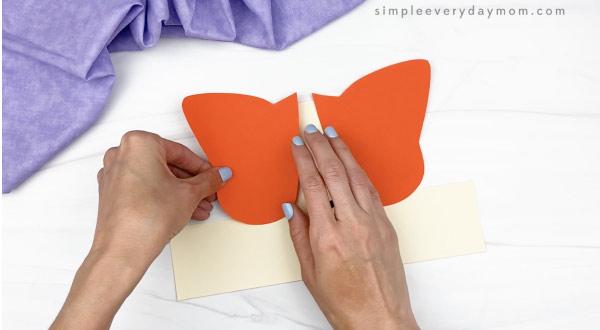 hand gluing spot to cat headband craft