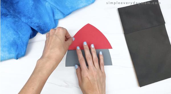 hand gluing rocket tip to rocket puppet