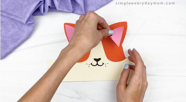hand gluing inner ear to cat headband craft