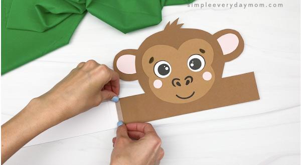 hand taping extender to monkey headband craft