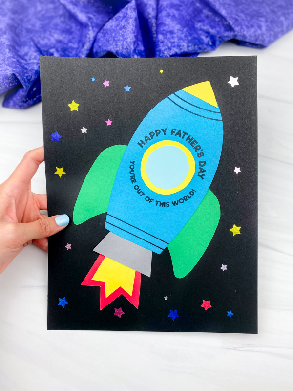 hand holding rocket father's day card