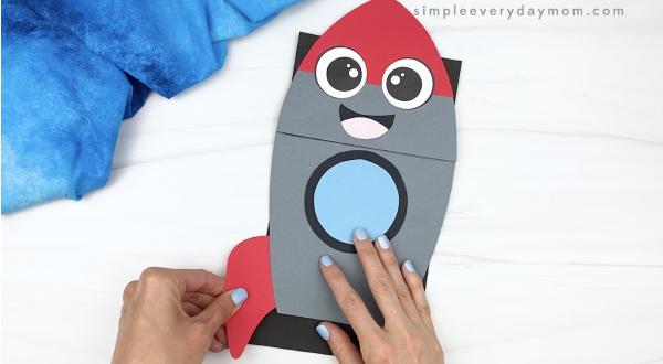 hand gluing fin to rocket puppet