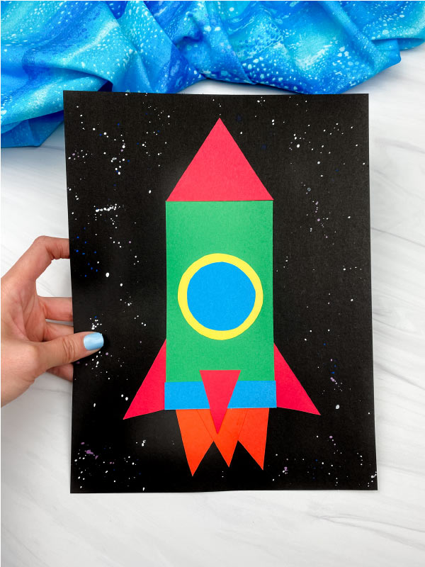 hand holding shape rocket craft