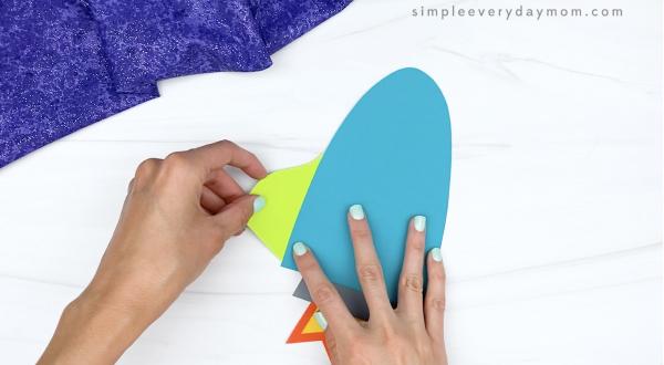 hand gluing fins to 3d rocket craft