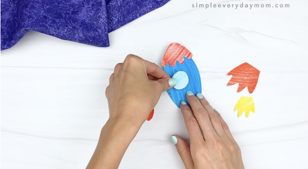 hand gluing window to cut and paste rocket craft