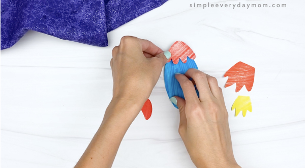 hand gluing tip to cut and paste rocket craft