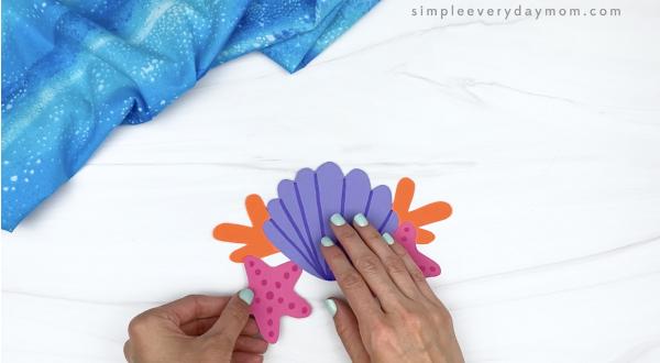 hand gluing starfish to mermaid headband craft