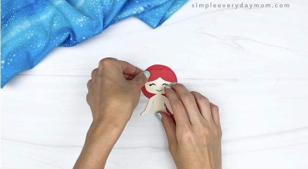 hand gluing bangs to toilet paper roll mermaid craft