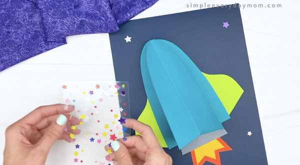 hand placing star stickers on paper