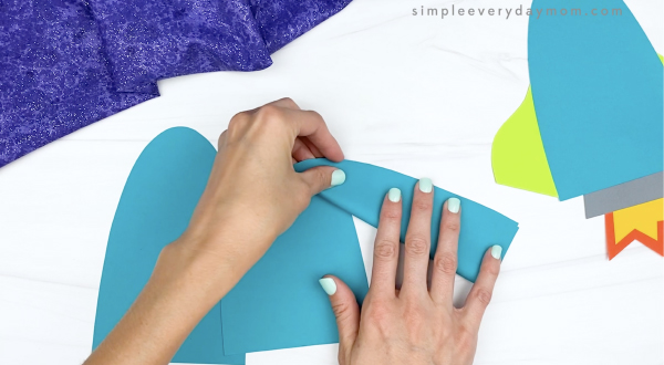 hand folding paper pieces in half