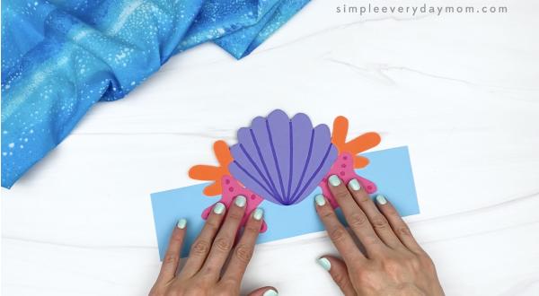 hand gluing pieces to mermaid headband craft