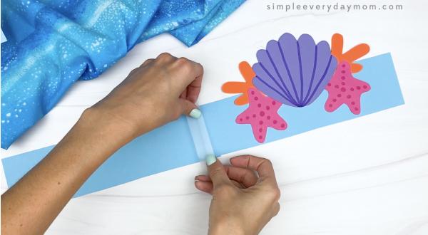 hand taping extender to mermaid headband craft