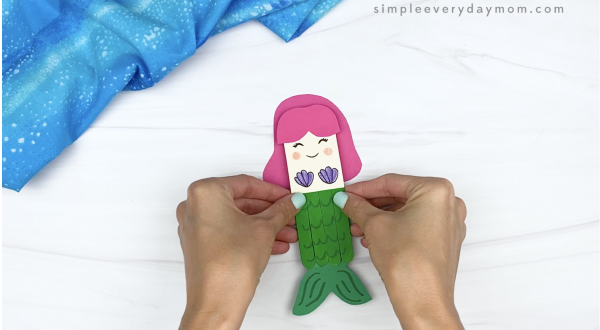 hand gluing hair to popsicle stick mermaid craft
