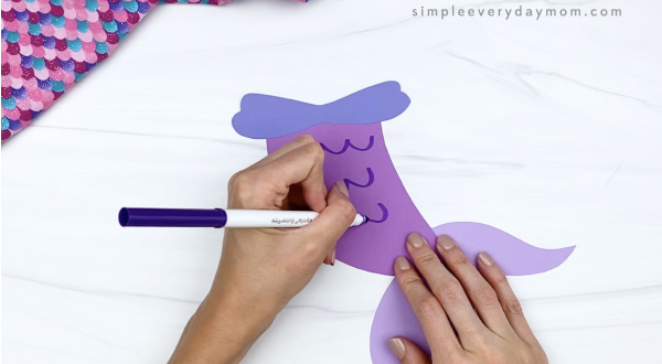 hand drawing scales on mermaid paper craft