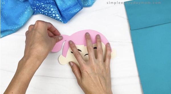 hand gluing hair to mermaid head