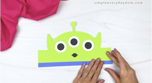 hand gluing rectangle to alien headband craft
