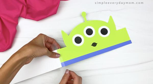 hand taping extender to alien headband craft