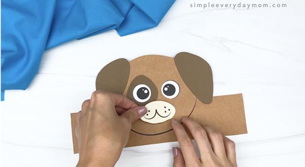 hand gluing mouth to dog headband craft