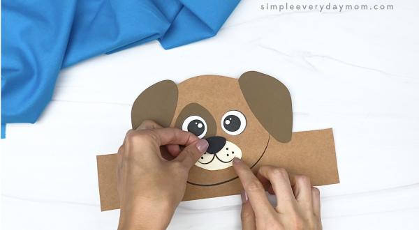 hand gluing nose to dog headband craft