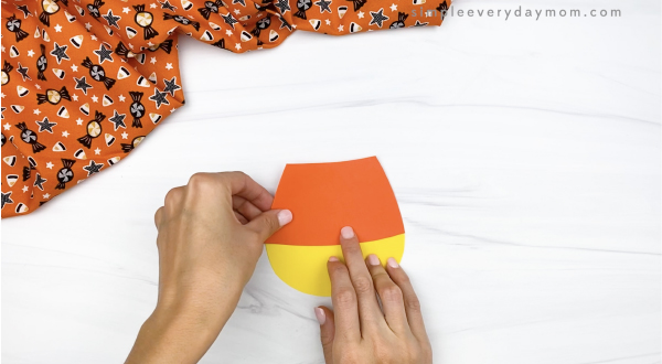 hand gluing candy corn middle to candy corn craft