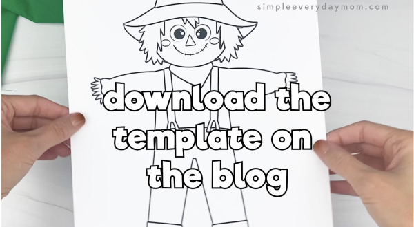 hand holding scarecrow art template