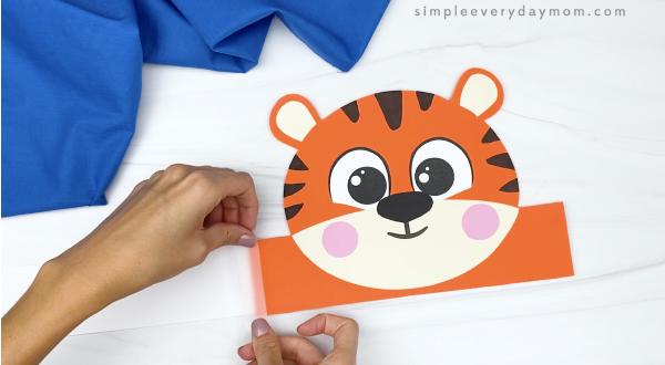 hand taping extender to tiger headband craft