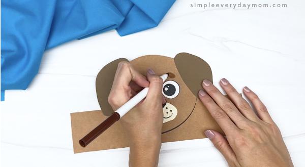 hand drawing eyebrow on dog headband craft