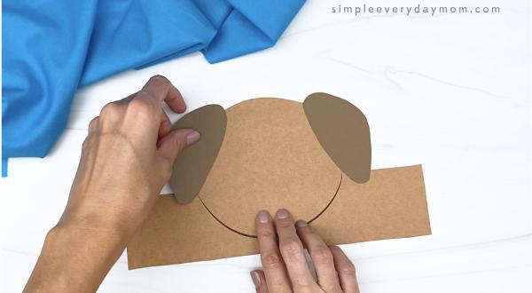 hand gluing ear to dog headband craft