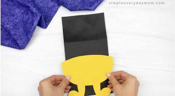 hand gluing legs to candy corn puppet craft