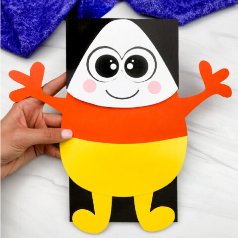 hand holding candy corn puppet craft