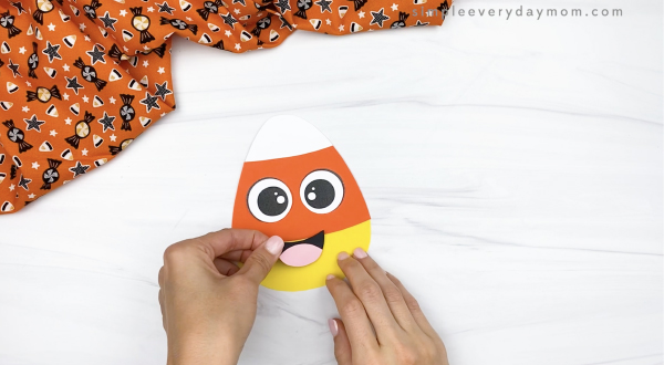hand gluing mouth to candy corn headband
