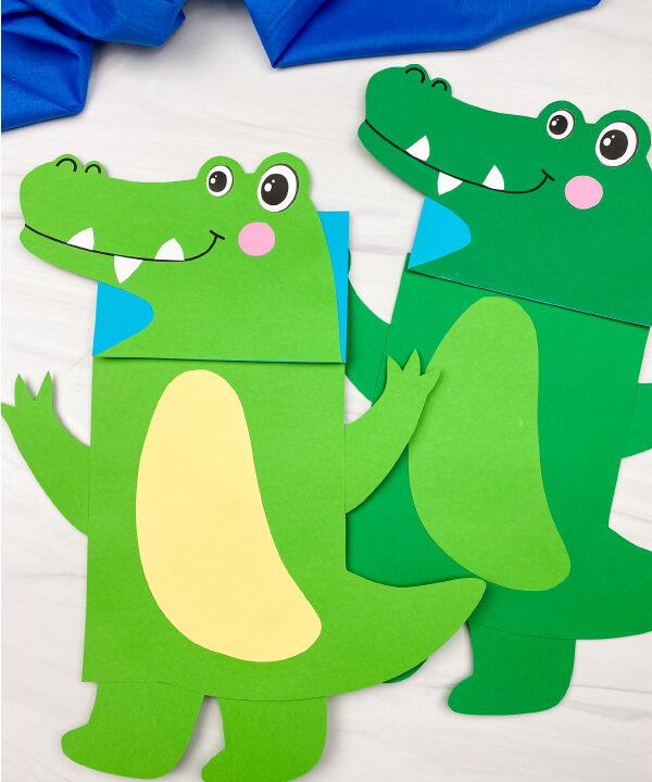 2 paper bag alligator puppets